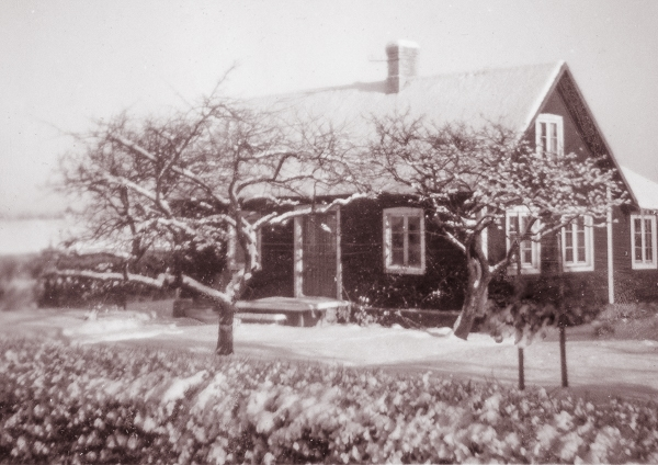 Vinterbild av huset vid Smiss 523.